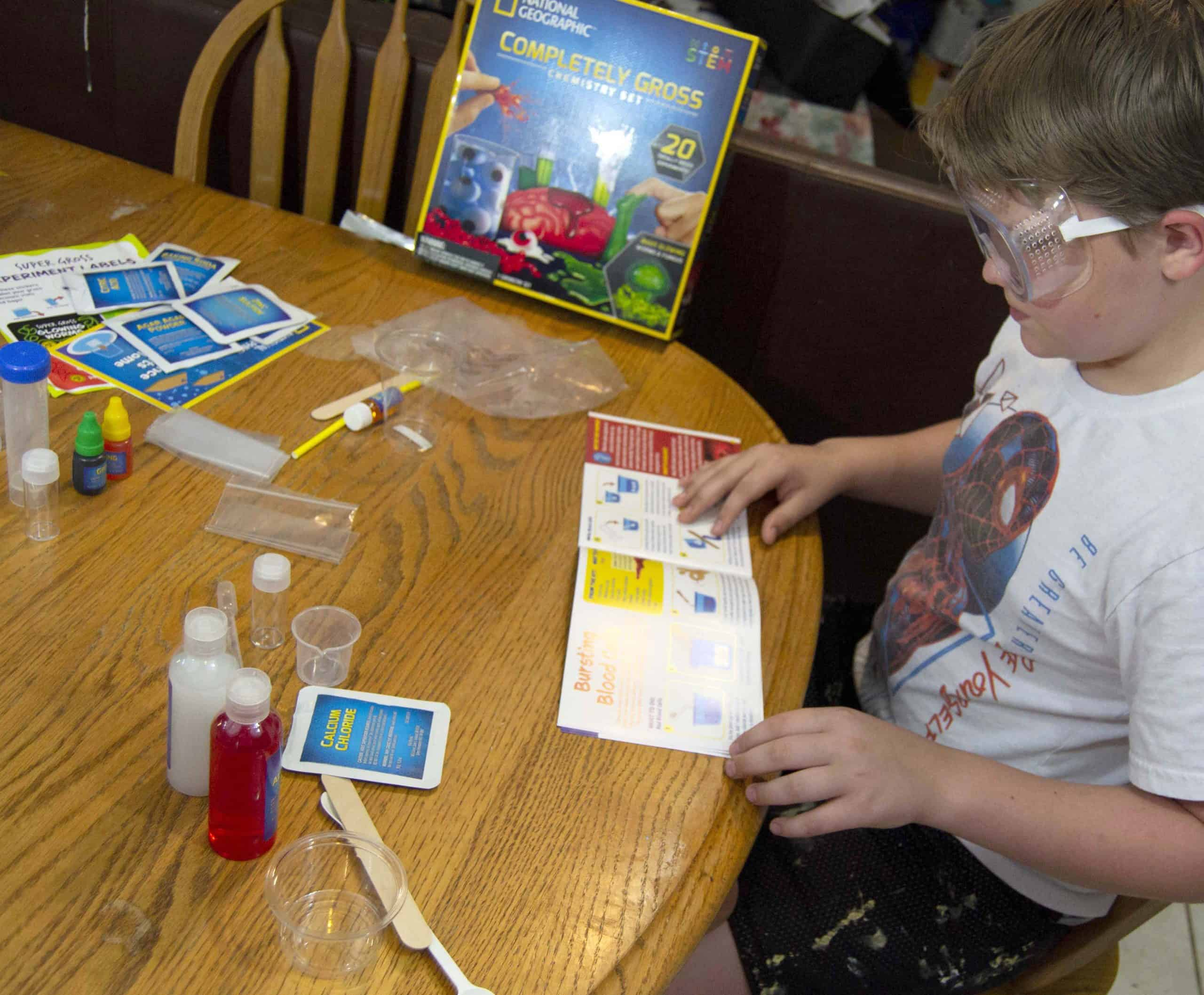 Boy with science kit for blog post on why science kits are worth it