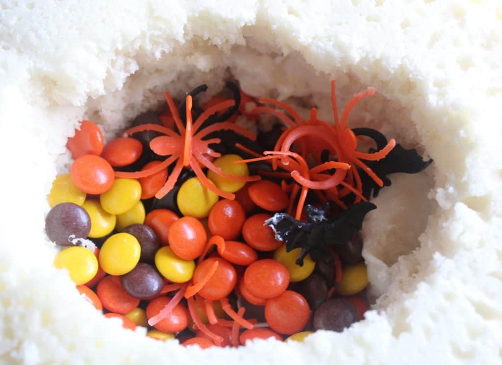 This Halloween Pinata Cake Recipe is an easy pinata cake recipe anyone can make! Learn how to make a pinata cake while making a great treat!